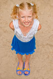 Playful, cheerful girl with two tails, looking from the bottom t Royalty Free Stock Images