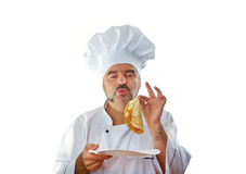 Playful Chef eats a pancake Stock Image