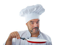 Playful chef holding a frying pan Stock Photography