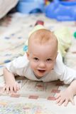 Playful child crawling on the carpet Stock Image