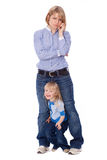 Playful child disturb mother to talk on cell. Looking at camera Royalty Free Stock Photography