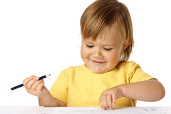 Playful child draw with crayons and smile Stock Image