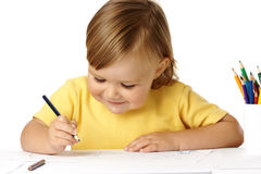 Playful child draw with crayons and smile Stock Photos