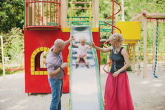 Playful child with parents at the playground outdoor Stock Photography
