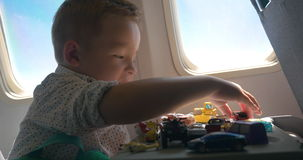 Playful child is ready for enjoyable flight stock footage