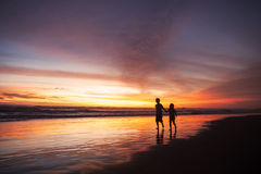 Playful children on beach at sunset time Royalty Free Stock Photos