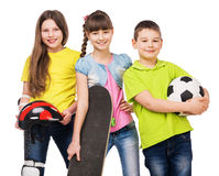 Playful children holding sport equipment in hands Royalty Free Stock Photos