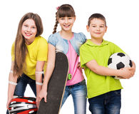 Playful children holding sport equipment in hands Royalty Free Stock Photo