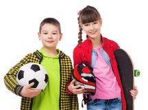 Playful children holding sport equipment in hands Royalty Free Stock Photography