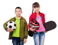 Playful children holding sport equipment in hands Royalty Free Stock Image