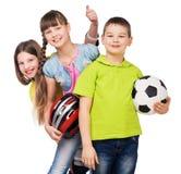 Playful Children Holding Sport Equipment In Hands Stock Image