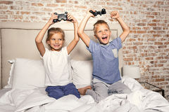 Playful children located in bedroom Royalty Free Stock Photo