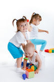 Playful children playing with toys Stock Photos