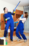 Playful cleaning premises team Royalty Free Stock Images