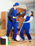 Playful cleaning team in uniform Royalty Free Stock Photography