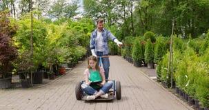Playful colleagues of botanic garden stock footage