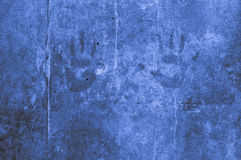 Playful colorful children hand impressions on a blue light grayi Royalty Free Stock Images