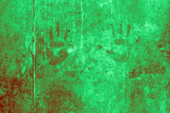playful colorful children hand impressions on a light dark green Royalty Free Stock Images
