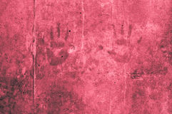 Playful colorful children hand impressions on a red reddish gray Stock Photography
