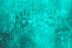 Playful colorful children hand impressions on a turquoise grayis Stock Photography