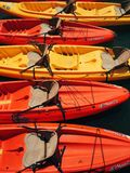 Playful colors of canoes Royalty Free Stock Photography
