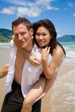Playful couple at the beach Stock Image