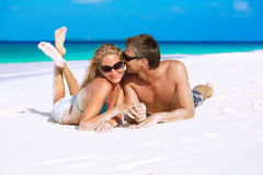 Playful couple on the beach Royalty Free Stock Photography