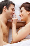 Playful couple in bed. Stock Image