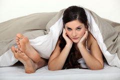 Playful couple in bed Stock Photos