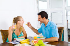 Playful couple breakfast Royalty Free Stock Photography