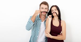 Playful couple fooling on valentine day. Beautiful young loving couple bonding to each other and smiling while making a stock images