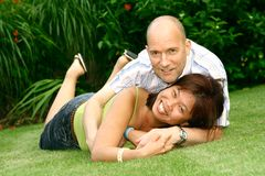 Playful couple in garden Stock Image