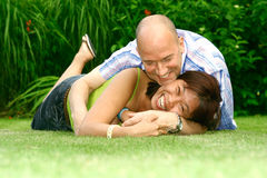 Playful couple in garden Stock Photos