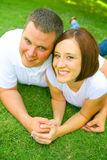 Playful Couple On Grass Royalty Free Stock Photography