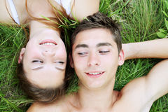 Playful couple in the grass Stock Photography