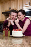 Playful Couple In The Kitchen - Vertical Royalty Free Stock Photos