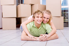 Playful couple with moving boxes Royalty Free Stock Photography