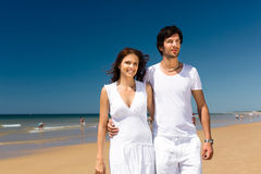Couple enjoying freedom on the beach Stock Photos