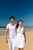 Couple enjoying freedom on the beach Royalty Free Stock Image