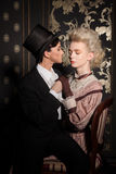 Playful couple in an old-fashioned clothing Royalty Free Stock Photography