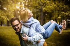 Playful couple at park. royalty free stock photos