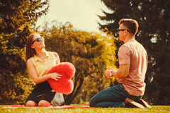 Playful couple in park. Stock Image