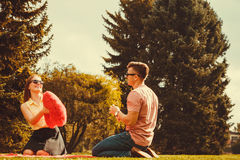 Playful couple in park. Stock Photos