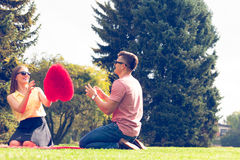 Playful couple in park. Royalty Free Stock Photography