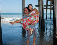 Playful couple sharing a smile Stock Images