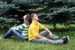 Playful couple sitting in park Royalty Free Stock Image