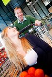 Playful Couple in Supermarket Royalty Free Stock Image