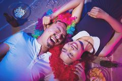 Playful couple. Playful  Vietnamese couple having fun during the party, view from the top Royalty Free Stock Images
