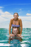 Playful couple in the water Royalty Free Stock Image