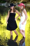 Playful Cowgirls. Two beautiful cowgirls in the great outdoors royalty free stock images